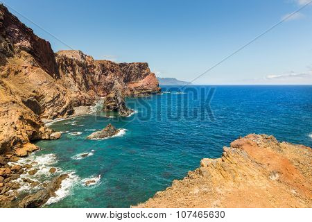 Summer ocean with rocky shore in sunny day, Portugal