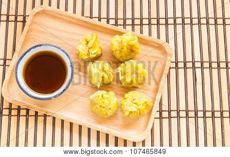Top View Fresh Dumplings With Hot Steams On Wood Plate
