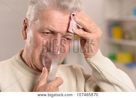 man with flu inhalation