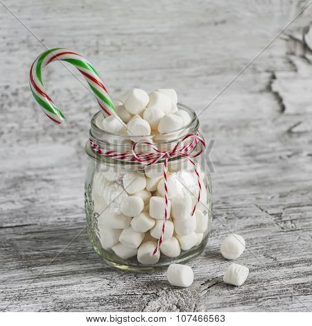 Marshmallows In A Glass Jar And Candy - Christmas Gift,  On A Light Wooden Surface, Vintage Style