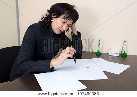 Business lady sitting in office
