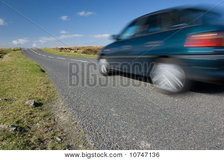 Car Speeding On Empty Road
