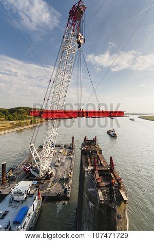 Swimming Crane In Action During Bridge Deconstruction