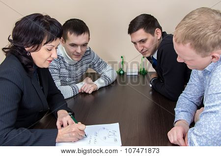 Four businessmans sitting in office