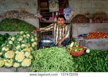 TULSIPUR, NEPAL - CIRCA JULY 2015: A vegetable seller at Tulsipur market.