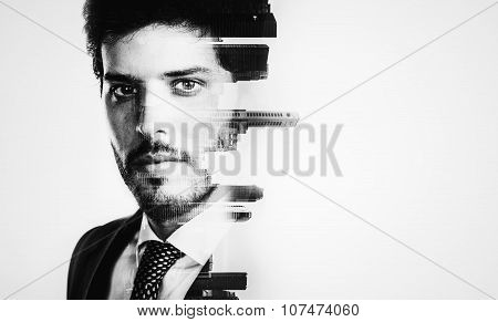 Bw portrait of young businessman and contemporary city on the background. Double exposure.