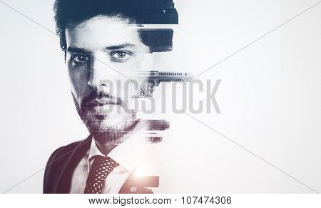 Bw portrait of young businessman and contemporary city on the background. Double exposure. Horizonta