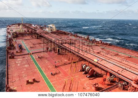 Oil tanker deck in open sea, while stormy weather.