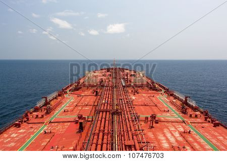Oil tanker deck under blue sunny sky. View from monkey deck.