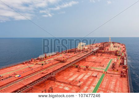 Crude oil carriers red deck with pipeline. Unusual perspective.