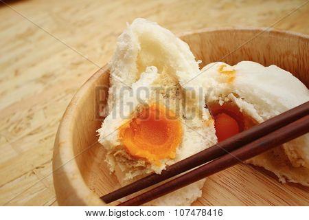 Steamed Dumpling - Chinese Bun On Brown Background.