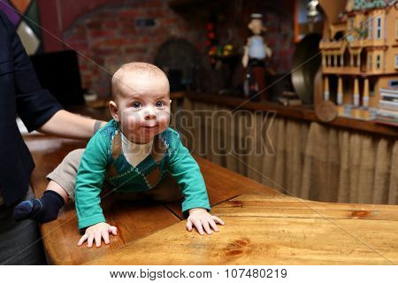 Baby Crawling On The Bar