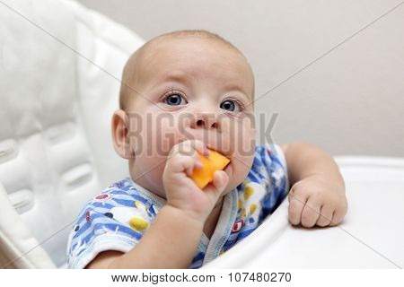Baby Eating Pumpkin