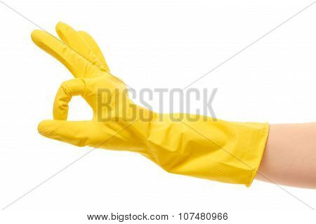 Close up of female hand in yellow protective rubber glove showing OK sign