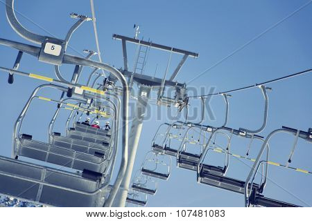 Filtered Vintage Photo Of Ski Chair Lift