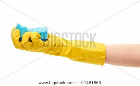 Close up of female hand in yellow protective rubber glove holding blue cleaning sponge