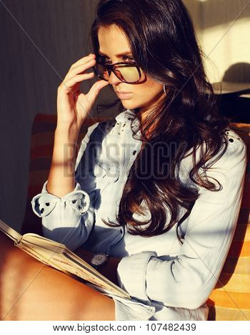 Beautiful Sexy Business Woman With Dark Curly Hair Reading A Book