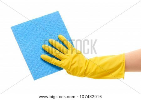 Close up of female hand in yellow protective rubber glove holding blue rag
