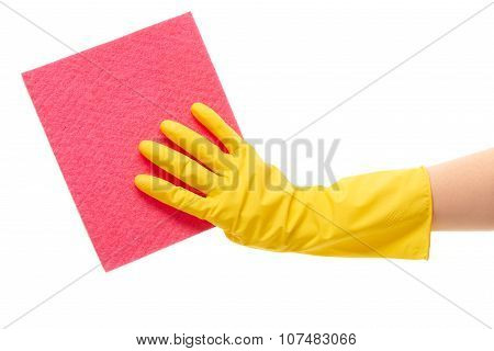 Close up of female hand in yellow protective rubber glove holding pink rag