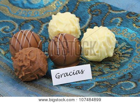 Gracias (thank you in Spanish) with assorted chocolates, pralines and truffles