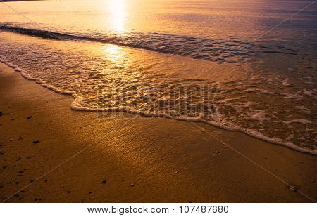 Sun reflection on the shallow sea water on the beach