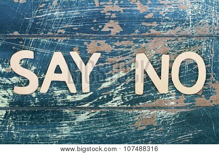 Say no written with wooden letters on rustic surface