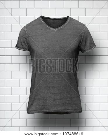 Dark tshirt isolated on the wall of bricks background