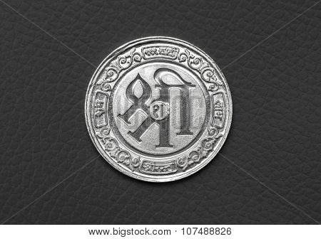 A silver coin with Sanskrit word 'Shri' (means Holy) . A hindu religious object.