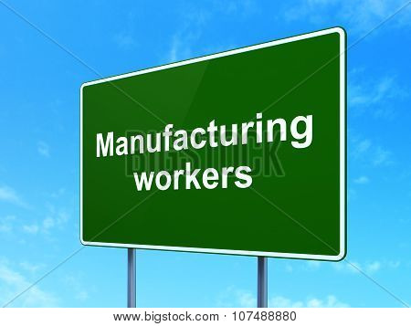 Industry concept: Manufacturing Workers on road sign background