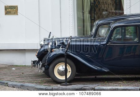 Two old Citroen cars parking in front of five stars Hotel Sofitel Legend Metropole Hanoi