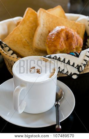 Hot Coffee With Bread In Background