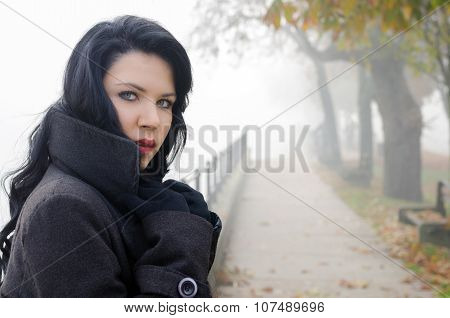 Portrait Of The Beautiful Girl Outdoor On Misty Autumn Day