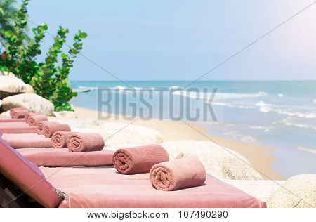 Empty Sunbed With Wrapped Towels On A Beautiful Beach