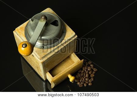Old, Historic, Manual Coffee Grinder On Isolated Black With Mirror.