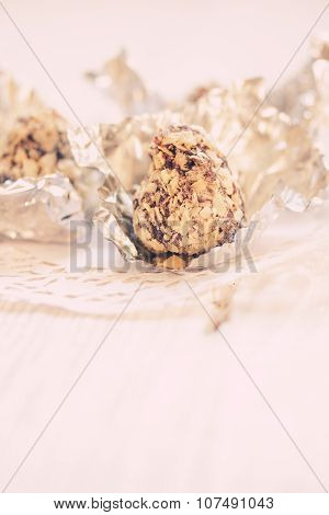 Candies In Chocolate And Crushed Wafers