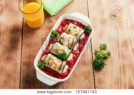 Baked eggplant with tomato sauce and cheese roll