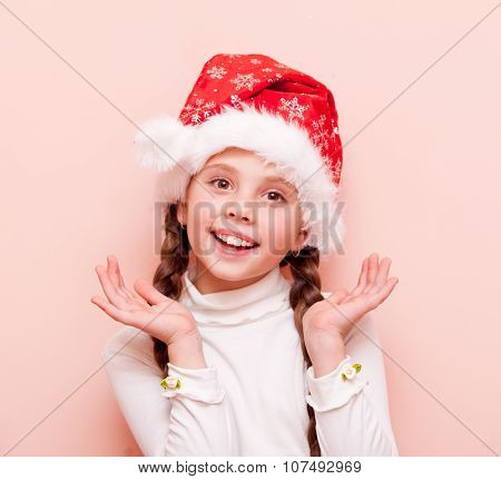 Girl With Pigtails In Santa Claus Hat