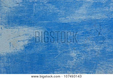 Trowel scratched background with dry plastering. Scratched blue texture.