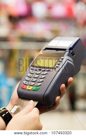 Woman Hand With Credit Card Swipe Through Terminal For Sale In Store
