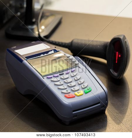 Credit Card Machine With Barcode Scanner In Background At The Store