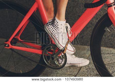 Young Woman Foot At Bicycle Pedal Closeup