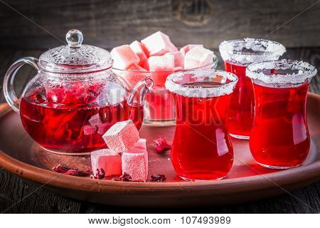 Hibiscus Tea In Glasses With Turkish Delight On Rustic Wooden Background.