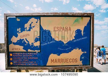 Old painted Information board on the beach Costa de la Luz in Ta