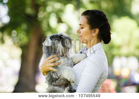 Young Woman Portrait With Dog Outdoors