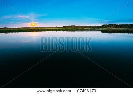 Wooden boards pier on Calm Water Of Lake, River