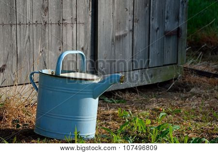Old vintage watering can in the garden