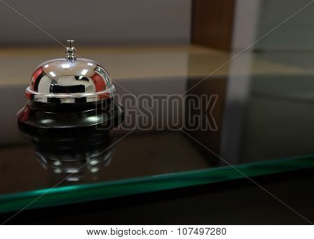 Service counter a bell to call for help or assistance at a front desk with blank copy space for your message