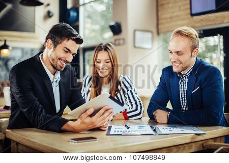 Small Group Of Young People At A Business Meeting In A Cafe