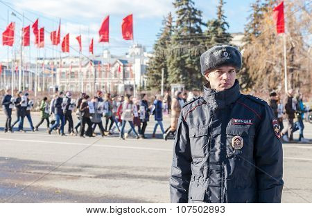 Russian Police Officer In Uniform Standing In The Cordon