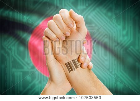 Barcode Id Number On Wrist And National Flag On Background - Bangladesh